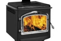 Napoleon Deluxe EPA Wood Stoves / Napoleon's Deluxe series wood stoves are available in the 3 sizes/models:  the 1100, the 1400, and the 1900.  All have a pedestal base and your choice of door colors. / by Fireplace Warehouse ETC