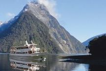 """Milford Sound Fly / Nature Cruise / Fly - Air Milford / This is an intimate experience with numbers capped at 150, and on-board Nature Guides offering personal attention. The """"Spirit of Milford"""" catamaran explores nooks and crannies along the edge of the fiord, nudging into sheer rock faces to examine flora and fauna in detail for 2 hours (15 minutes longer than the Milford Sound Scenic Cruise)."""