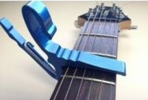 Guitar Accessories / Guitar hangers and Capos in every color.