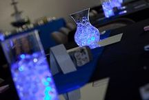 Wedding Centerpiece Ideas with LED Battery Operated Tea Lights / BlueDot Trading makes both Battery Operated LED Submersible Underwater Tea Lights and Battery Operated LED Flickering Flame TeaLights.  They make Beautiful Centerpieces.