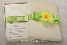 Destination Wedding / Beautiful and unique handmade invitations adorned with beautiful embellishments and metallic and satin ribbon www.boxedweddinginvitations.com