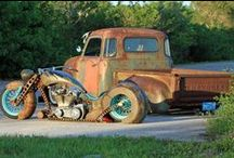 "Rat Rod / A rat rod is a style of hot rod or custom car that, in most cases, imitates (or exaggerates) the early Hot Rods of the 1940s, 1950s, and early-1960s. The style is not to be confused with the somewhat closely related ""traditional"" Hot Rod, which is an accurate re-creation or period-correct restoration of a Hot Rod from the same era.Most Rat Rods appear ""unfinished"", regardless of their status, as only the vehicle's bare essentials are driven."