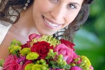 Norton's Weddings - Hot Pink/Orange/Green/Red / Wedding flowers in Green and Hot Pink. Pergola decorations to match.