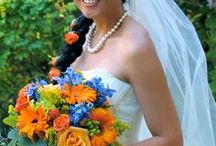 Norton's Weddings - Orange/Blue/Yellow / In Ann Arbor, blue & gold weddings are pretty common, but this bride slipped in some added vibrancy with orange Roses & Gerberas.