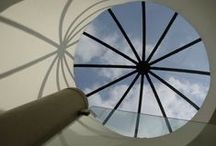 Sky Lights, Floors and Walls / Whether you want a curved double-glazed frameless octagonal roof, a simple minimally framed internal partition or a walk-on switchable fitted floor, we can help. One-off or repeat designs, economical or state of the art, large or small, we can help.