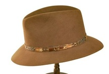 Outback Hats / Outback hats are often described as Australia's version of the American cowboy hat. They typically have a wider brim that will do out or down on the edges for ample sun protection.
