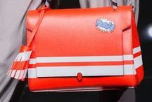 ANYA HINDMARCH / This season's theme was school girl customisation, Anya's childhood habit for sticking stickers on her school books was immortalised in leather; has accessorising your bag with stickers it seems have knocked the fluffy bag bug off the trend top spot next season?