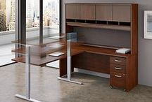 Bush Business Furniture: Height Adjustable Desks / Height Adjustable Standing Desks provide a flexible, healthy and ergonomic solution for today's work environments. With the push of a button this desk moves from a sitting position to standing for the ultimate in user comfort and a personalized approach for the way you work.