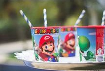 Super Mario Themed Party / This board is filled with details from my son's first birthday party, that was inspired by Super Mario and his colorful world. / Esse mural foi feito com fotos dos detalhes da foto do aniversário de um ano do meu filho, que teve como tema o mundo colorido do Mario Bros.