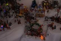 Lemax Village - Santa's Wonderland in an 8ft Christmas Tree / Following on from my earlier Christmas Tree Village displays, I decided to do the whole Lemax Santa's Wonderland series in an 8ft tree. The base needed extension as I could not fit the whole series into the tree without it caving in.
