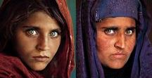 """""""Afghan Girl"""" portrait by Steve McCurry / Afghan Girl is a 1984 photographic portrait by journalist Steve McCurry which appeared on the June 1985 cover of National Geographic. The image is of a young woman with green eyes in a red headscarf looking intently at the camera. It has been likened to Leonardo da Vinci's painting of the Mona Lisa and has been called """"the First World's Third World Mona Lisa"""". The image became """"emblematic""""... - Follow me if you like it! :)"""