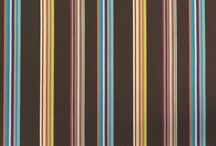 Monte and Paul Smith / Add a fashionable touch to your Monte Design Rocker or Glider with a lumbar pillow decked out in stripes by Paul Smith for Maharam.