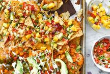 Nachos / Layers of chips and mounds of toppings