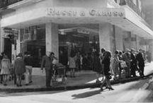 Historia / Los orígenes de la firma se remontan a 1868, tiempos en que los primeros talleres ya eran reconocidos por la calidad de sus monturas, botas y artículos para los antiguos carruajes.  En 1941, ya con el nombre de Rossi & Caruso, la firma afianza sus valores y la pujanza que la caracteriza, para convertirse en sinónimo indiscutido de calidad e innovación exquisitas.