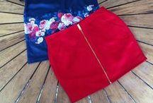 Saias / Objeto de Vestuário. Peça de roupa, geralmente feminina, de comprimento variável, que se prende na cintura e que cobre os membros inferiores. Ou parte do vestido, de comprimento variável, que cobre da cintura para baixo.