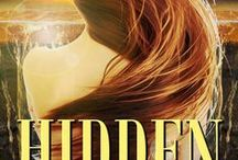 HIDDEN (Five Fates Series, book 1) / As a demi-goddess life should be easy. For Jade, it's not. When the prophecy, created by the Three Fates, activates a shadow inside her, a repressed yearning for a different life surges to the surface. It threatens to consume her. In order to survive, she enlists the help of Roen, a Worr demon with glowing blue eyes. Together, can they outsmart the prophecy and change fate? Or, will one careless mistake cost her not only her life, but her greatest love?