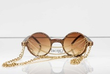 Enerjiee by Sherine (Eyewear, Sunglasses & Accessories) / Enerjiee is an accessory lifestyle line that is hand embellished from the whims of the designer, Sherine Patrick. Spawning from a love for fashion and a history of performance, including attending Fiorello H. LaGuardia Performing Arts high school in NYC, Enerjiee was curated as another extension of creativity for the designer. With the precise use of the Swarovski crystals, spike, chains, jewelry and more, each piece is dressed with a mixture of elegance and edge.