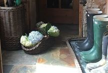 Entryway & Mudroom / Get the clutter out of the mud room by organizing with baskets.