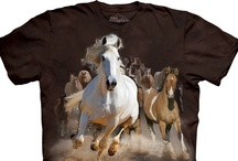 Horse T-Shirts / It's a well-know fact that most girls have a thing for horses to some degree, whether they are enthusiastic horse riders or they  just fancy the four legged muscular animals and the idea and symbol of the prince on the white horse. Either way, we think horses are awesome too, which is why we have a great collection horse tee shirts with all kinds of sick designs that might intrigue women and girls. We have running horses, loving horses, horse collages and so on.