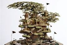 Artist: Takanori Aiba / Takanori Aiba worked as a maze illustrator for Japanese fashion magazine Popye.  After that he worked as an architect. In 2003 he  merged the two crafts -design of physical space and  drawing of labyrinths- into these incredibly detailed tiny worlds. Aiba constructs sprawling miniature communities that wrap around bonsai trees, lighthouses, and amongst the cliffs of nearly vertical islands. Who wouldn't love to visit every single one of these places, if only we were 5 to 6 feet shorter.