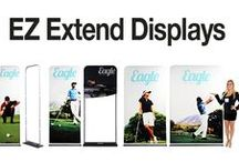 Tubular EZ Extend Displays / The new EZ Extend Displays are a push-pin tube frame system with a full color dye sublimation graphic that slips over the frame like a pillow case.  The printed graphics can be single or double-sided print.  Choose from 4 different widths: 2ft, 3ft, 4ft, and 5ft wide Chose from 7 different heights: 5.5ft, 6.5ft, 7.5ft, 8.5ft, 9.5ft, 10.5ft and 11.5ft tall  Great way to get your message way up there!
