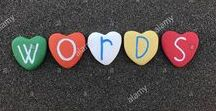 STONES ART WORDS / Words and sentences with colored stones with sand background