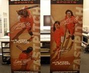 Premium Banner Stands / Premium Retractable Banner Stands for you next Trade Show or Event.  These banner stands are made with sturdy hardware and offer features that enhance your next expo like lighting, counters, interchangeable graphics, etc.