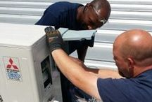Compass Team at Work / Compass Heating and Air Conditioning, Inc.  members in the field