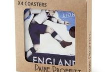 World Cup Gifts / A selection of Limited Edition products by Paine Proffitt, brought to you by Genesis Sports.  Paine Proffit is an English-based, American sports artist, licensed by Genesis Sports, to produce an exclusive range of t-shirts, mugs and coasters. The catalogue has been launched in time for the 2014 World Cup.