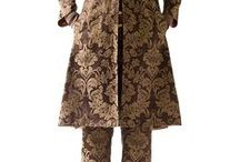 San Marco Couture Cafta Coat / The sumptuous Venetian Brocades created to upholster gondolas are their common denominator. The Italian unexpected fabrics, made with the knowledge coming from the past and with the hands belonging to innovation, are the detail which makes them Unique Pieces. The reference to the East in their shape, which is insiperd by the caftan, the stiches everywhere, make San Marco Coat an object in the purest Raptus&Rose tradition.  Which will be yours?