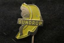 Sundrop Bananas Advertising / Featuring a variety of lapel pins produced by the Netherlands-based Sundrop Banana Company.