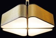 "Quadrifoglio Lighting Collection by Oasis / play with the subtle four-leaf clover design and the satin finishings of the lampshade, to create an ambient of sophisticated, upscale class. The ""Quadrifoglio"" hanging lamp comes with adjustable cables. Its Deluxe version sports a metal stem in antiqued gold finish."