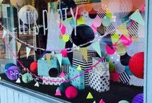 Creative ways to Display Gift Wrap / Inspiring ideas for displaying wrapping paper and ribbon in retail environments.