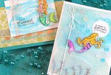 "Mermaid Crossing - Mermaid Stamp Set / This stamp set features sweet little mermaid images! These lovely sea friends are perfect for sending ""FIN-tastic"" birthday wishes or ""we're MERMAID for each other"" sentiments!"