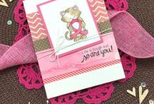 Newton's Support - Support Ribbon Cat Stamp Set / This little 3 x 4 stamp set featuring Newton holding a ribbon will be perfect for you to use to show your support! The ribbon can be colored in any color so it's easy to customize it for the cause you wish to represent.