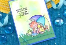 Newton's Rainy Day - Spring Cat Stamp Set / When it's going to rain, make sure to pack your umbrella! This sweet 3 x 4 stamp set features Newton sharing his umbrella with a cute little duck!