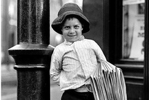 Newsboys, New York City 1900s / Newspaper boys, also called 'newsboys' or 'newsies', were the main distributors of newspapers to the general public from the mid-19th to the early 20th century in the United States. They were not employees of the newspapers but rather purchased the papers from the publishers and sold them as independent agents. Not allowed to return unsold papers, the newsboys typically earned around 30 cents a day and often worked until very late at night.