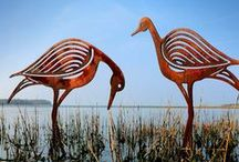 Contemporary Garden Art - Bird Sculptures for the Garden / Contemporary garden sculptures crafted form rusted metal. With their curvaceous contemporary lines the bird sculptures make great pieces of garden sculpture / garden art.