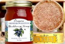 Honeys / Our honey is produced by busy bees and their fantastic beekeepers right here in the Columbia River Gorge. Oregon Growers & Shippers honey is raw and unfiltered to preserve the subtle flavors and natural enzymes, collected from a variety of Snowberry, Chokecherry, Clover and wild Dandelion blossoms.  One of nature's sweetest products and another one of the Columbia River Gorge's delicious attributes!