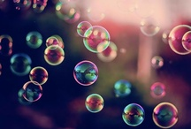 "Bubbly / ""Two bubbles found they had rainbows on their curves.