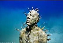 """Underwater Art Cancun / Artificial reef created by the artist Jason deCaires Taylor, presenting a magnificent collection of 400 underwater sculptures. .  """"The Silent Evolution"""" Life-size statues described by the artist as: """"Forming a vast gathering of people aiming to define a new era of living in a symbiotic relationship with nature"""" this is Jason's most ambitious work to date"""