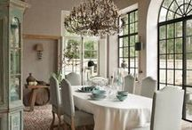 Dining / Wood dining chairs, large reclaimed barnboard tables, and glass chandeliers.