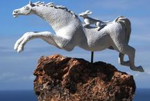 LEAPING HORSES  / My latest Leaping Horse series are lively and expressive; I have mounted my ceramic sculptures of the leaping horses over ancient South African igneous rock, some of which have crystals embedded in them. The horses appear as if leaping over a rocky outcrop.