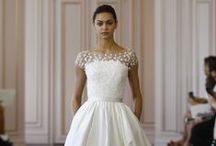 "Oscar de la Renta Spring Summer 2016 / ""It's her prerogative to be the center of attention,"" says newly appointed Oscar de la Renta designer Peter Copping of the modern bride's mentality. Copping stayed true to the house's elegant and feminine codes for his first bridal show, while incorporating subtle twists—plunging-back here, lace inserts there—that ensure the spotlight stays where it should: on the bride. Or more specifically: on her entrance as she walks down the aisle."