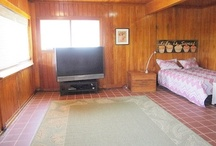 Cottage Room / The Cottage Room is the largest of the bedrooms (ex. the Master).  It's a huge wood-paneled bedroom that sleeps four with a Queen bed, two bunk beds, and a big screen tv.   It is set apart from the other rooms with its' own private hallway.