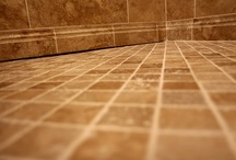 Light Walnut Travertine Shower with Hidden Curbless Drain / Shower tiled with Light Walnut Travertine from @TheTileShop and a recessed frameless shower glass enclosure along with our Hidden Curbless Shower drain in the back of the shower.
