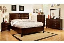Bedroom Furniture /  The classic lines of this unique bedroom group are accented by the padded leatherette headboard. Finished in a brown cherry. The bed has drawers in the footboard for extra storage.