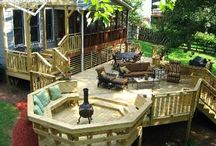 Backyard / Backyard: Small upper deck with large lower deck Built in planters  Play area Firepit or chimenea