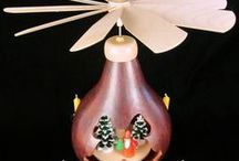 Gourd Carousels / Hand-made gourd cutouts with silhouette designs and displays inside. The fan above is powered by candle!