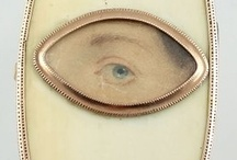 """Lovers Eye"" Gems / In 1784, at age 22, the Prince of Wales, George IV, became infatuated with an older woman and widow – Maria Fitzherbert.  After his relentless pursuit, on December 15, 1785, Maria agreed to ""marry"" the smitten prince. The two were united in a form of secret,  illegal, marriage.  Why? Mrs. Fitzherbert was Catholic, quite a problem at that time. Had they officially married, he would not have become king.  The story goes the two commissioned mini eye portraits made to wear as symbols of their love."